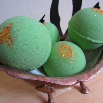 Pot of Gold Bath Bomb!  Lucky leprechaun! Dip into a bath of Rosemary, Lemongrass and Grapefuit Essential Oils with a dash of gold glitter!