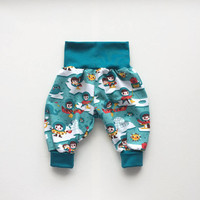 Blue bubble pants with inuit. Comfy slouchy infant pants with blue fold over waistband and cuffs. Baby harem pants. Organic cotton.