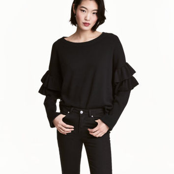 H&M Sweater with Ruffles $34.99