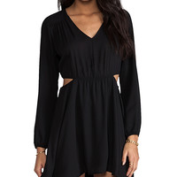 Donna Mizani Double Side Cut Out Flounce Dress in Black
