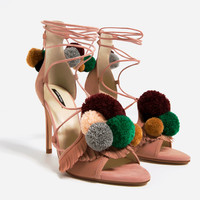 LEATHER HIGH HEEL SANDALS WITH POMPOMS
