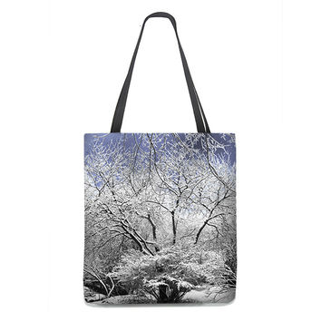 Snow Laced Trees Tote Bag with blue sky