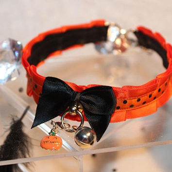 Premade thin kittenplay petplay Halloween collar with orange base + dot print and pumpkin charm