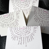 Merry Christmas, Happy New Year in 12 languages. Printed and hand drawn. Small folded card, 2015 in Roman numbers. white, grey, pink.
