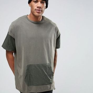 ASOS Super Oversized Longline T-Shirt With Kangaroo Pocket And Drawcord Hem In Green at asos.com