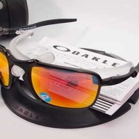 New Oakley Badman® Polarized OO6020-03 Dark Carbon - Ruby Iridium Lenses. $400.