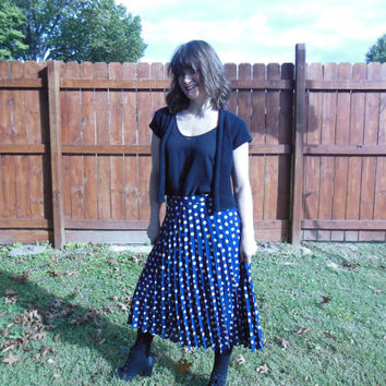 Vintage 1970's navy blue pleated midi skirt with yellow and white polka dots.