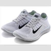 NIKE knitting flying line casual sports shoes White gray black