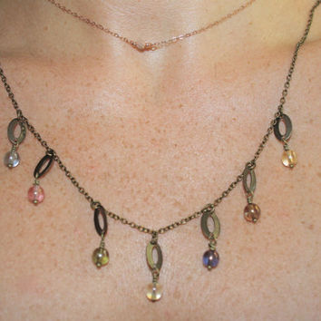 Multicolored glass bead necklace with oval brass charms CANDY SHOP