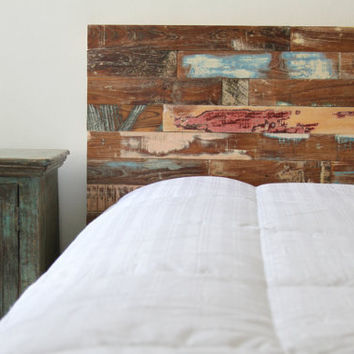 Painted headboard made from reclaimed wood