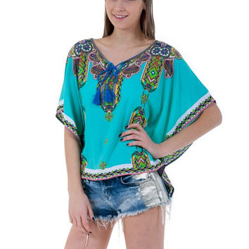 (amw) Poncho style in a aqua tribal print shirt