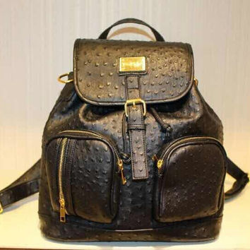 Black ostrich backpack with 18k gold accents