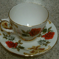 Teacup and saucer with gold rim and accents red rose Sutherland fine bone China