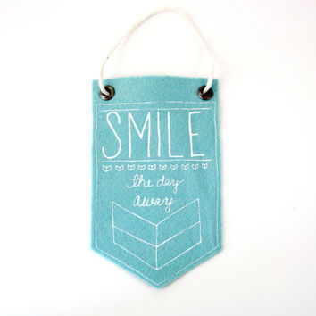 Mini-Banner wall hanging, Smile The Day Away, light blue wool blend felt, screen print in white ink