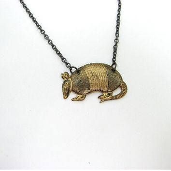 blackened armadillo necklace