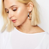 Cheap Monday Playin Hoop Earrings at asos.com