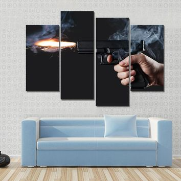 Shot From A Handgun With Fire And Smoke Multi Panel Canvas Wall Art