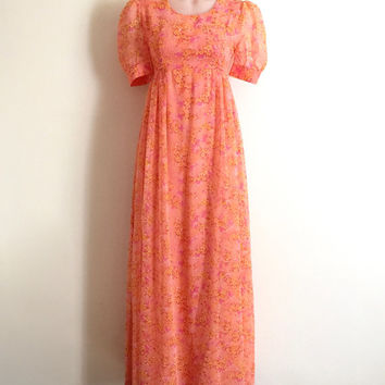 Vintage 1970s bright floral print empire line maxi dress with short sheer puff sleeves and gathered skirt