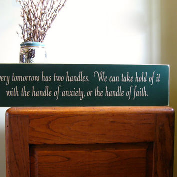 Every tomorrow has two handles.  We can take hold of it with the handle of anxiety, or the handle of faith custom wood sign