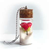 Rose in a snow globe bottle necklace