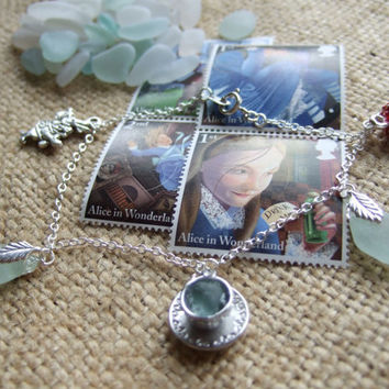 Alice in Wonderland inspired bracelet with tiny teacup filled with sea glass, Scottish sea glass pendants, rabbit and fly agaric charms