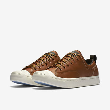 The Converse Jack Purcell Tumbled Leather Low Top Unisex Shoe.