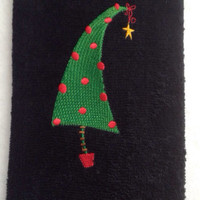 Retro Christmas tree on a black kithen or bath towel