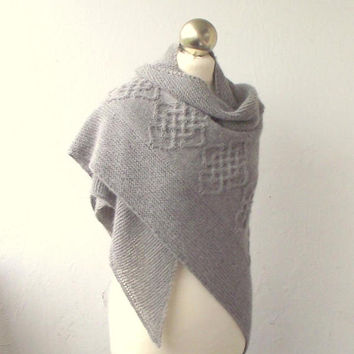 Grey hand knitted  alpaca shawl with celtic cable motifs