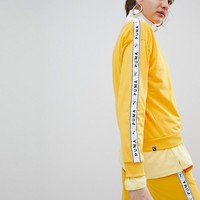 Puma Exclusive To ASOS Sweatshirt With Taping In Yellow at asos.com