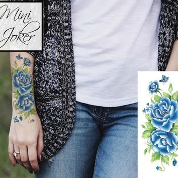 Mini Joker | Awesome Tattoos Two Blue Roses Tattoo