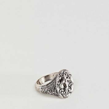 Reclaimed Vintage inspired signet ring with bird design exclusive at ASOS at asos.com