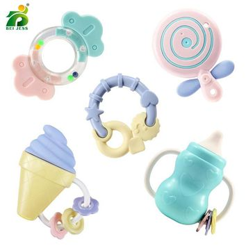 5 sets / sets of baby rattles cartoon lollipop bottles of soft silicone plastic hand bell BEI JESS baby toys