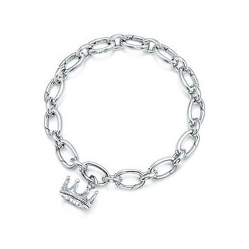 Tiffany & Co. | Item | Crown charm in sterling silver. | United States