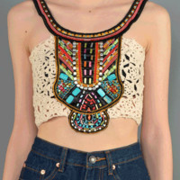 Heat up the summer with the I Love My Tribal Crochet Crop Top. This sleeveless crop top features crochet knit, contrasting woven and bead embellished tribal panel at front and shoulder straps, scoop neckline, and cropped construction. Pair with high waist