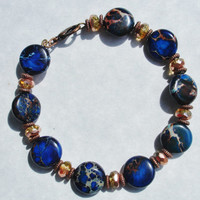 Blue bracelet jasper bracelet with faceted metallic copper and antiqued copper beads
