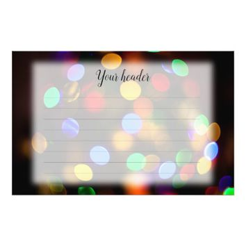 Multicolored Christmas lights. Lined stationery. Stationery