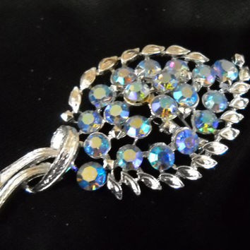 Vintage Coro Leaf shaped Brooch with coloured rhinestone- like stones surrounded by silver with tie effect