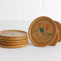 Vintage Set of Six Wood Maine Coasters with Lighthouse, Red Lobster, Pine Tree, Compass and State Outline in Holder