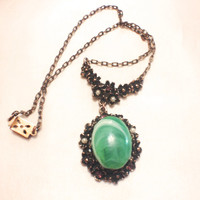 Vintage Victorian Revival Lavalier Necklace with Large Green Cabochon, Seed Pearls and Magenta Rhinestones.  Peanut chain
