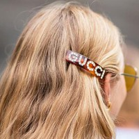 GUCCI Women Fashion New Diamond Letter Side Clip Leisure Decoration Personality Hair Clip Orange