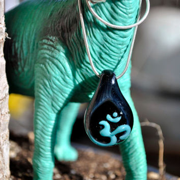 Hand Blown Glass OM / AUM pendant , black and turquoise galaxy Boro blown glass