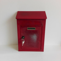Old french red mail box on galvanized metal.French vintage