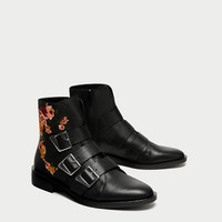 FLAT LEATHER ANKLE BOOTS WITH EMBROIDERY AND BUCKLES DETAILS