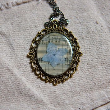 pressed flower jewelry resin pendant blue hydrangea on vintage music bronze setting extra long chain green