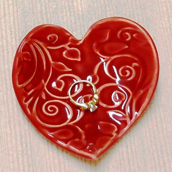 Hand built textured heart jewelry dish in ruby red glaze on white stoneware