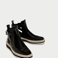 FLAT CUT-OUT ANKLE BOOTS