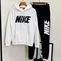 NIKE 2018 autumn and winter models trend wild casual men and women sports running two-piece white