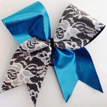 Super Cute Tick Tock Cheer Bow with Sparkly Blue Lycra and White Lace on Black Ribbon