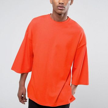 ASOS Oversized T-Shirt With Extreme Wide Sleeves In Orange Heavyweight Jersey at asos.com