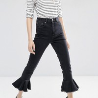 ASOS FARLEIGH High Waist Slim Mom Jeans in Washed Black with Flared Frill Hem at asos.com